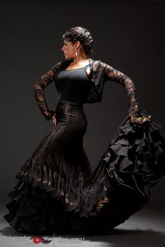 "This is a portrait of famed flamenco dancer Nelida Tirado by dance photographer Chasi Annexy.  What I love most about this photo is the intricate details of Neli's costume.  From the lace to the powerful ruffles of her skirt.  We wrote a story ""The Heart of Her Dance"" featured on SALSEEK.com"