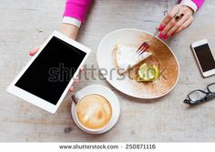 Woman holding tablet computer while sitting in cafe