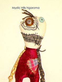 "Lurch is 36 cm tall or 14"" .He is 8cm or 3 "" wide. Lurch is made from a mix of new and upcycled fabrics. He has a machine and hand embroided face. His eyes are vintage buttons from my button collection."