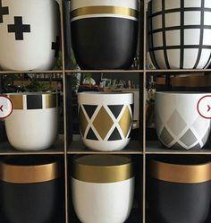 With terra cotta pots. Cheaper and original