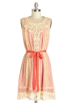 This perfectly pink number looks great with its ribbon belt, or worn without as a sunny shift!