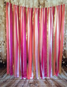 Featured is a wide x tall Coral, Fuschia, Gold and White fabric streamer backdrop. Streamer Backdrop, Party Streamers, Fabric Backdrop, Ballon Backdrop, Rainbow Party Decorations, Dance Decorations, Streamer Decorations, Decorating With Streamers, Rainbow Parties