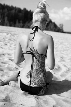 I WANT ONE!!! Amazing back tattoo covering the side as well. Too bad we can't see the colours.