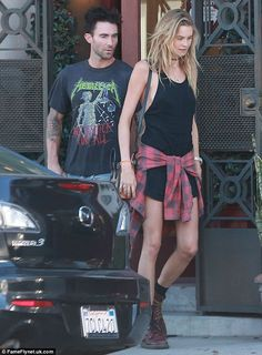 Married life: Maroon 5 lead singer Adam Levine, 35, and his supermodel wife Behati Prinsloo, 25, were spotted - similarly dressed in rock 'n...