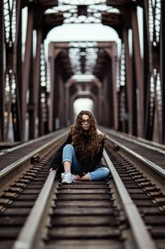 young girl sitting on an abandon train track under a bridge – girl photoshoot Portrait Photography Poses, Photography Poses Women, Creative Photography, Amazing Photography, Wide Angle Photography, Autumn Photography, Track Pictures, Poses For Pictures, Shotting Photo