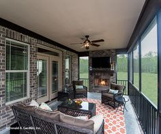 This spacious screened porch offers plenty of space to relax and enjoy the fireplace in cooler weather. The Spotswood - Plan 1310. http://www.dongardner.com/house-plan/1310/the-spotswood. #ScreenedPorch #Fireplace #OutdoorLiving