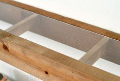 DIY floating wood shelves with plexi glass insert.  Blogger says that Lowes will cut plexi to size. kh