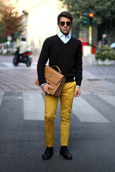 Shop this look for $327:  http://lookastic.com/men/looks/longsleeve-shirt-and-v-neck-sweater-and-briefcase-and-chinos-and-socks-and-tassel-loafers/1671  — Light Blue Longsleeve Shirt  — Black V-neck Sweater  — Tan Leather Briefcase  — Mustard Chinos  — Black Socks  — Burgundy Leather Tassel Loafers
