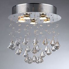 Maximize the luxury of your home with this beautiful round crystal chandelier. Featuring simple and glittering crystals, this chandelier has five lights for ample lighting.