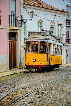 The vintage yellow trams still moving around in the old neighborhoods. Alfama, Lisboa. #Portugal
