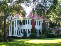 Beautiful old Southern Plantation...for sale! It even has a pecan grove! One of my biggest dreams is to own a beautiful southern plantation and fill it with antiques!