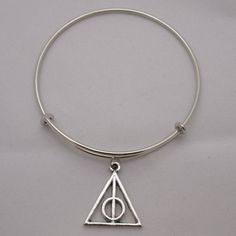 SALE! Harry Potter Deathly Hallows Symbol Antique Silver Charm... (€11) ❤ liked on Polyvore featuring jewelry, bracelets, circle charm, adjustable bangle bracelet, charm bracelet bangle, triangle jewelry and expandable charm bangle