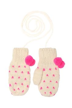 Hark back to yesteryear with a classic pair of mittens on a string! Hand-knitted mittens feature a chunky cream knit with tiny pink hearts and ribbed hem. Topped off with bright pink pom poms and a long string to loop through your coat sleeves. You'll never lose your gloves again! These mittens have been made from a chunky wool and acrylic blend.   Spotty Mittens by Miss Pom Pom. Accessories - Winter Accessories Edinburgh, Scotland, United Kingdom