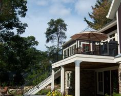 Aluminum glass railing on cottage with glass railing on staircase