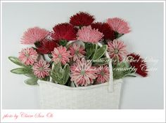 Quilled basket of carnations by Claire
