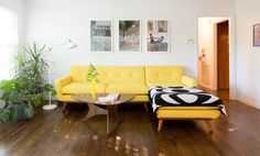 """Balee and Dylan's modern yellow couch came from LexMod. """"It was such a fun big purchase and it has been an awesome centerpiece to decorate around."""""""