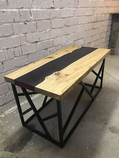 Stylish live edge coffee table in the River style. Made of solid wood Ilm and epoxy resin with a blackberry tint. The legs of the table are made of metal and painted black. Size: 100 x 50 x 50 cm Material: Solid wood Ilm, epoxy resin, metal