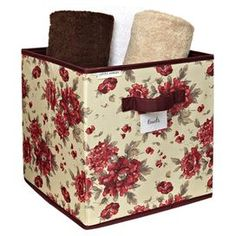 Storage cube with a floral motif.Product: Storage cubeConstruction Material: PolyesterColor: Milner cranberryDimensions: 12 H x 12 W x 12 D