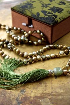 Sage green mala necklace Khaki green pearl boho by ThePillowBook Book Necklace, Fringe Necklace, Green Necklace, Khaki Green, Olive Green, Book Jewelry, Fabric Gift Bags, Jade Beads, Silver Flowers