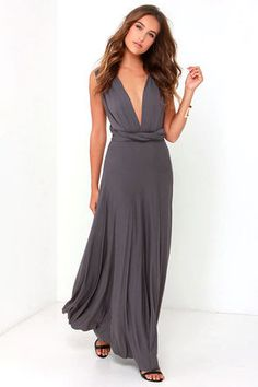 "Lulus Exclusive! Versatility at its finest, the Tricks of the Trade Dark Grey Maxi Dress knows a trick or two... or four! Two, 72"" long lengths of fabric sprout from an elastic waistband and wrap into a multitude of bodice styles including halter, one-shoulder, cross-front, strapless, and more. Stretchy, jersey knit hugs your curves as you discover new ways to play with this fascinating frock. Full, maxi-length skirt has a raw hemline. Want Styling Tips? <a href='http://bit.ly/HowToWearIt'…"