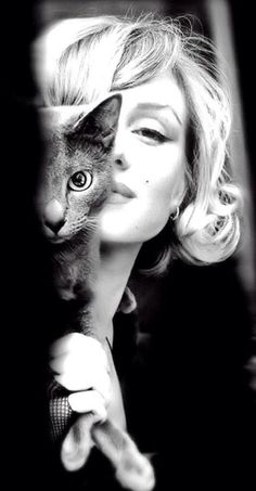 Marilyn Monroe with her kitty! How sweet!