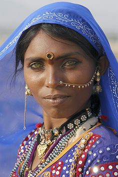 Rajasthan woman, India (I love the contrast of her pale eyes and beautiful skin. This combination of features makes me think of Arian).
