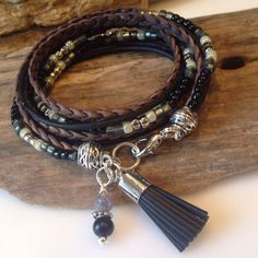 This gorgeous beaded bohemian wrap bracelet is rich with textures and colors of grey, silver black and cream! The braided cord used in this