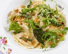 Wonton ravioli - simple to make pleasure to eat with sage, butter, pine nut sauce.