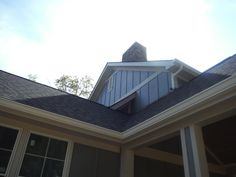 Close-up of Hardie Gray Slate Board & Batten. Hardie Board Siding, Board And Batten Siding, Shingle Siding, Exterior Siding, Slate Board, Andersen Windows, Metal Roof, New Construction, Mansions