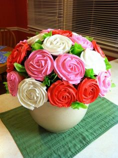 Rose Cupcake Bouquet (Using a Styrofoam Ball).  Use 2 toothpicks inserted into ball to hold each cupcake in place.  Start from the bottom up.  If the icing doesn't adhere to the cupcake, place a layer of icing on cupcake before adding the roses.