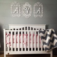 Pink and grey nursery!! I love how her name turned out above the crib.