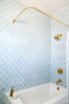 Emily Henderson's Blue Scallop Tiled Bathroom with Gold Brass Curved Rod