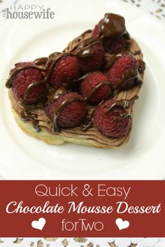 Quick and Easy Chocolate Mousse Dessert ~ served on top of flaky puff pastry and topped with fresh raspberries and a drizzle of homemade chocolate sauce. | The Happy Housewife