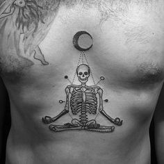 SUPERB chest TATTOO of a skeleton sitting under a moon in a meditating position.