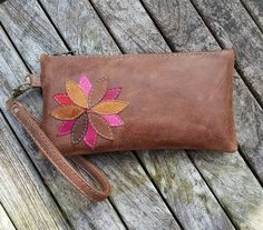 Leather clutch bag, brown with coloured flower