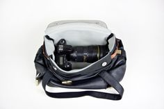 The Any Bag Camera Bag Insert: I've been using a neoprene lunch bag inside my handbag, but this dedicated camera bag insert is a much neater solution. 5 exterior pockets, magnetic snap closure, leather side handles. $59 #Camera_Bag #Photography_Gear