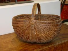 Oblong Basket with Dark Patina   With rib-type construction, the rich color tone of this basket reflects years of use.    ~ ITEM DETAILS ~ Dimensions: L 16 inches  Date / Circa: Late 19th century  Maker / Origin: Pennsylvania  Medium: Oak splint ~♥~