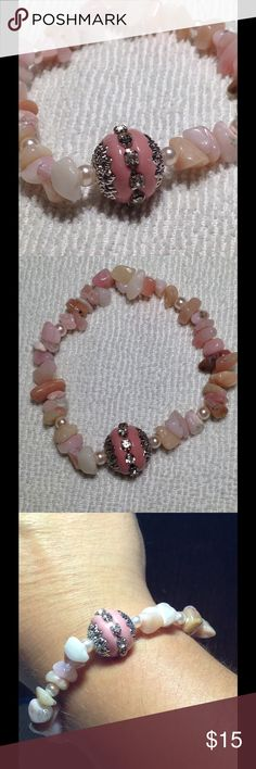 Pretty in Pink Opal Stretch Bracelet This is made with beautiful pink opal chips! The colors are very light and feminine. The Indonesian charm is silver plated and adorned with crystals. PeaceFrog Jewelry Bracelets