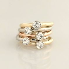 Diamond stacking rings.  In white, yellow, and rose gold with bezel set diamonds. DFJD.
