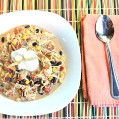 Crock Pot Cream Cheese Chicken Chili: 2 frozen chicken breasts 1 can Rotel (undrained) 1 can sweet corn (undrained) 1 can black beans (drained & rinsed) 1 package dry Ranch dressing mix 1 tsp cumin 1 tsp onion powder  1 Tbsp chili powder 1 8 oz block light cream cheese Low 6-8 hours
