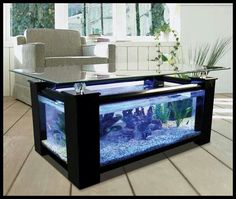 Beautiful coffee table comes with large built in aquarium. Beautiful coffee table comes with large built in aquarium. Beautiful coffee table comes with large built in aquarium.