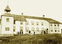 Staff and students assembled outside Norway House Indian Residential School. 1910.