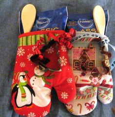 Cute idea. Oven mitt, cookie mix, spoon and cookie cutter.