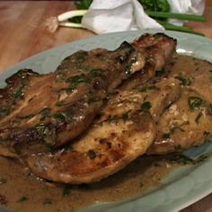 Thursday-Smothered Pork Chops with mashed potatoes and broccoli