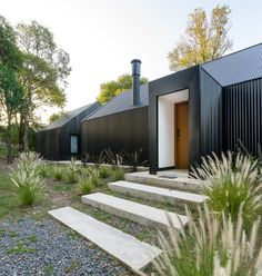 morini black house, 'la negrita,' is nestled among a forest in argentina Shed Design, Loft Design, House Design, Black House Exterior, Interior Exterior, Contemporary Cabin, Modern Barn House, Modern Houses, Cabin In The Woods