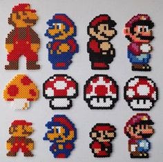 Did all of these last night which show Mario throughout the NES/SNES years and it's cool to see how the sprite progressed and when the Mushroom gained s. The Big and Small of Mario Perler Bead Art Perler Bead Designs, Perler Bead Templates, Pearler Bead Patterns, Hama Beads Design, Perler Patterns, Hama Beads Mario, Diy Perler Beads, Pearler Beads, Fuse Beads