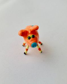 Mini Smiling Pig Orange With Teal Patches and Orange and Yellow Striped Legs
