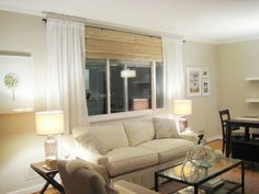 Sheer curtains over wood blinds, simple and goes with my theme for the house