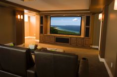 11 Ultra-Luxe Home Movie Theaters You Have To See To Believe Double-wide seats and a decked-out snack table make this basement home theater the epitome of movie-loving luxury. Home Theater Decor, Best Home Theater, At Home Movie Theater, Home Theater Speakers, Home Theater Projectors, Home Theater Rooms, Home Theater Design, Home Theater Seating, Cinema Room