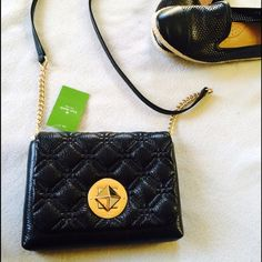 """2/13 HOST PICK Kate Spade Quilted Crossbody Chic NWT Crossbody from Kate Spade! Model is Kate Spade Naomi Astor Court in the sold out black color way. Item has 14-karat light gold plated hardware with turn lock closure and bright colored interior with Kate Spade print. Has an interior slide pocket and measures approximately 5.3""""h x 7.9""""w x 1.5""""d with a strap length of approximately 46.1"""". Please note while item is NWT there may be tiny scratches on the hardware as item does not come with…"""